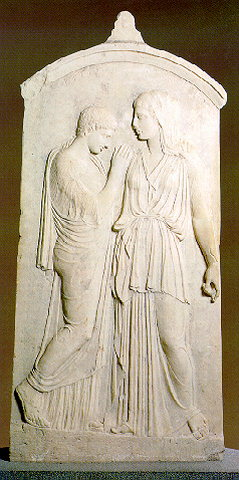GRAVE STELE OF KRITO AND TIMARISTA - Grave stele of Krito and Timarista with two standing female figures. Timarista, fullface, in a chiton and peplos embraces Krito, who is dressed in a chiton and himation and has short hair. 420-410 BC.
