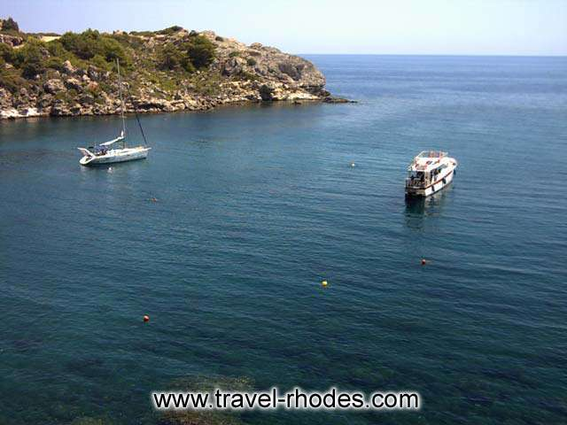 YACHTS - A yacht and a motor yacht in Ladiko bay in Rhodes