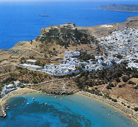 LINDOS VIEW - Its houses, perched on the hillsides, stand out in dazzling white against the blue background of sky and sea.