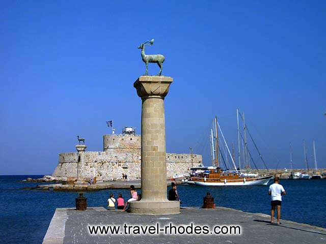 The famous entrance into Rhodes port with the two brassy deers that dominate the entry to the harbour. RHODES PHOTO GALLERY - RHODES PORT